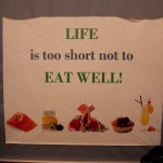 Skylt i saluhall: Life is too short not to eat well
